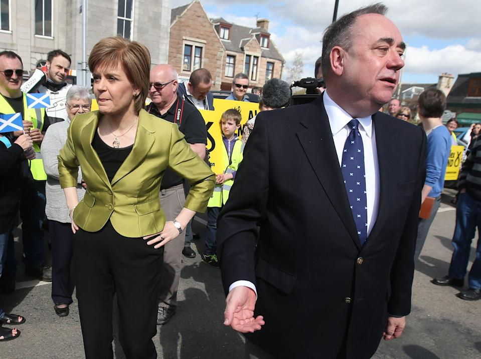 <p>Nicola Sturgeon with Alex Salmond on the campaign trail in Inverurie in 2015</p> (PA)