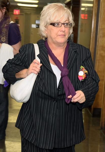 "FILE - In this Sept. 23, 2011 file photo, Barbara Sheehan leaves a New York courtroom as her trial breaks for the day. Sheehan, who was accused of fatally shooting her retired police officer husband, was eventually acquitted of murder when the jury believed that she shot him in self-defense. Sheehan's adult children have written a book about their mother's ordeal entitled, ""In Bed With the Badge: The Barbara Sheehan Story."" The book will be published Tuesday, July 17, 2012, through Changing Lives Press, and also as an e-book. (AP Photo/Rick Maiman, File)"