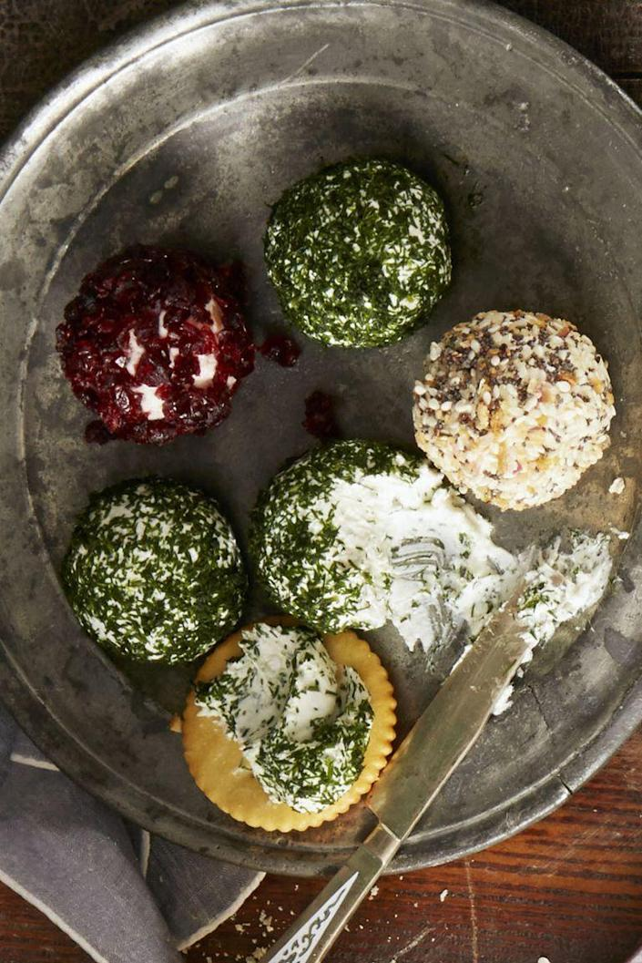 """<p>This updated take on a 1950s classic gets the mini treatment. If you wrap them tightly, these fun-sized apps will keep in the fridge for up to a week. There's also three other flavor combos to play with.</p><p><a href=""""https://www.goodhousekeeping.com/food-recipes/easy/a35164/trio-of-cheese-balls/"""" rel=""""nofollow noopener"""" target=""""_blank"""" data-ylk=""""slk:Get the recipe for Everything Cheese Balls »"""" class=""""link rapid-noclick-resp""""><em>Get the recipe for Everything Cheese Balls <em><em>»</em></em></em></a></p>"""