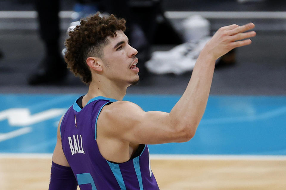 CHARLOTTE, NORTH CAROLINA - JANUARY 30: LaMelo Ball #2 of the Charlotte Hornets reacts following a three point basket during the first quarter of their game against the Milwaukee Bucks at Spectrum Center on January 30, 2021 in Charlotte, North Carolina. NOTE TO USER: User expressly acknowledges and agrees that, by downloading and or using this photograph, User is consenting to the terms and conditions of the Getty Images License Agreement. (Photo by Jared C. Tilton/Getty Images)
