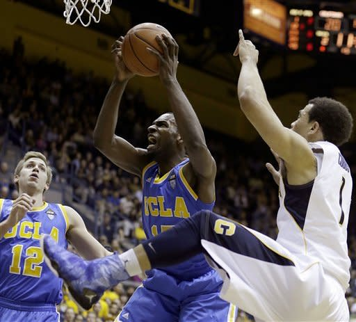 UCLA's Shabazz Muhammad, center, shoots against California's Justin Cobbs, right, as UCLA's David Wear (12) watches during the first half of an NCAA college basketball game, Thursday, Feb. 14, 2013, in Berkeley, Calif. (AP Photo/Ben Margot)