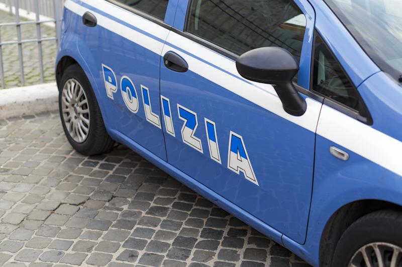 Blue police car with inscription police in Italian