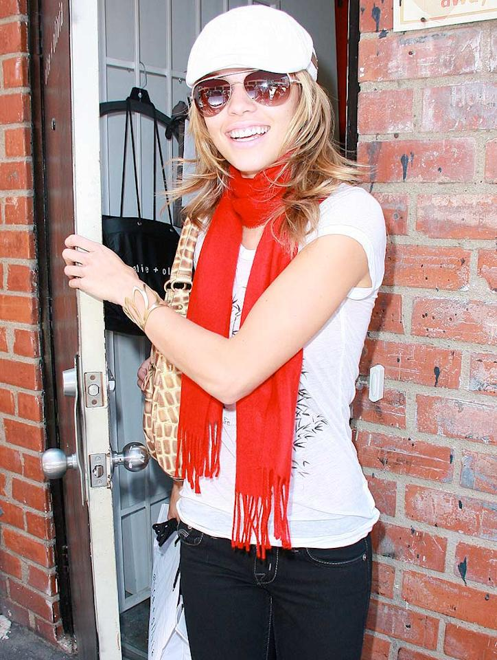 "AnnaLynne McCord's strikes a pose in a funky newsboy cap, scarlet scarf, white tee, and dark blue jeans. EM/<a href=""http://www.x17online.com"" target=""new"">X17 Online</a> - June 4, 2009"