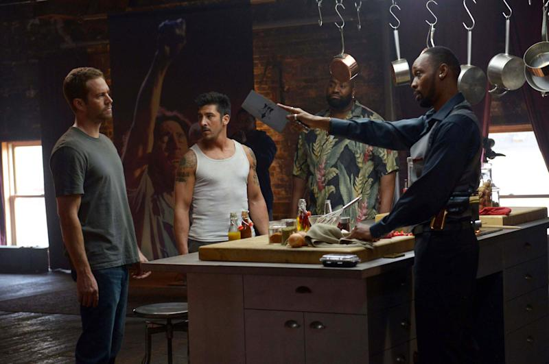 """This image released by Relativity Media shows, from left, Paul Walker, David Belle, Kwasi Songui and RZA in a scene from """"Brick Mansions."""" (AP Photo/Relativity Media, Philippe Bosse)"""