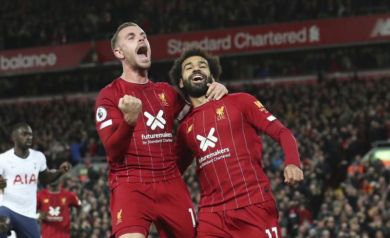 Mohamed Salah (right) and Jordan Henderson scored the goals as Liverpool rallied to beat Tottenham at Anfield. (AP)