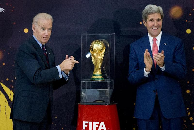 Vice President Joe Biden and Secretary of State John Kerry applaud after unveiling the FIFA World Cup trophy, the actual trophy that will be awarded to the winner of this year's World Cup soccer tournament in Brazil, during a ceremony at the State Department in Washington, Monday, April 14, 2014. (AP Photo/Manuel Balce Ceneta)