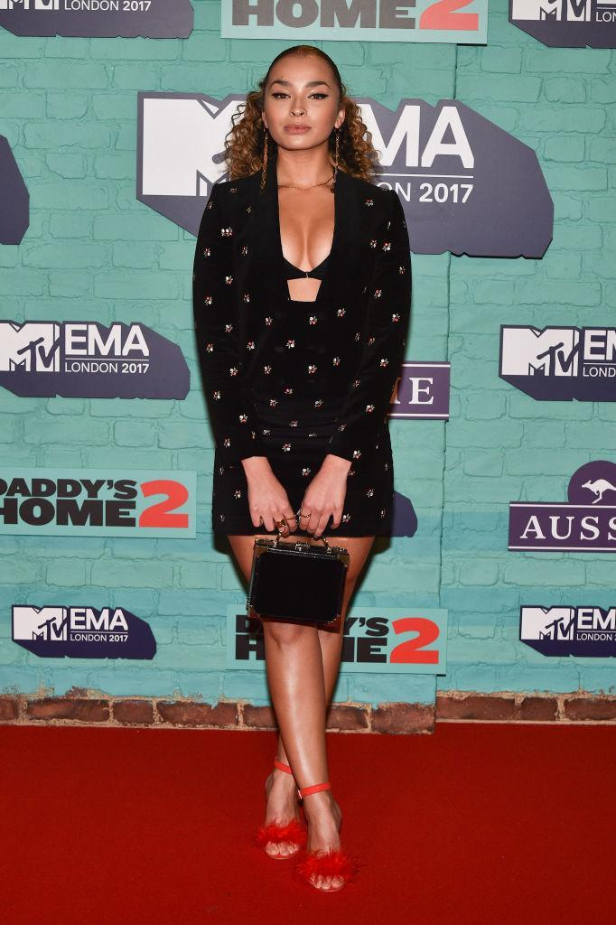 <p>Ella Eyre coordinated for the occasion in a two-piece set that she accessorised with fluffy heels. (Photo: Getty Images) </p>