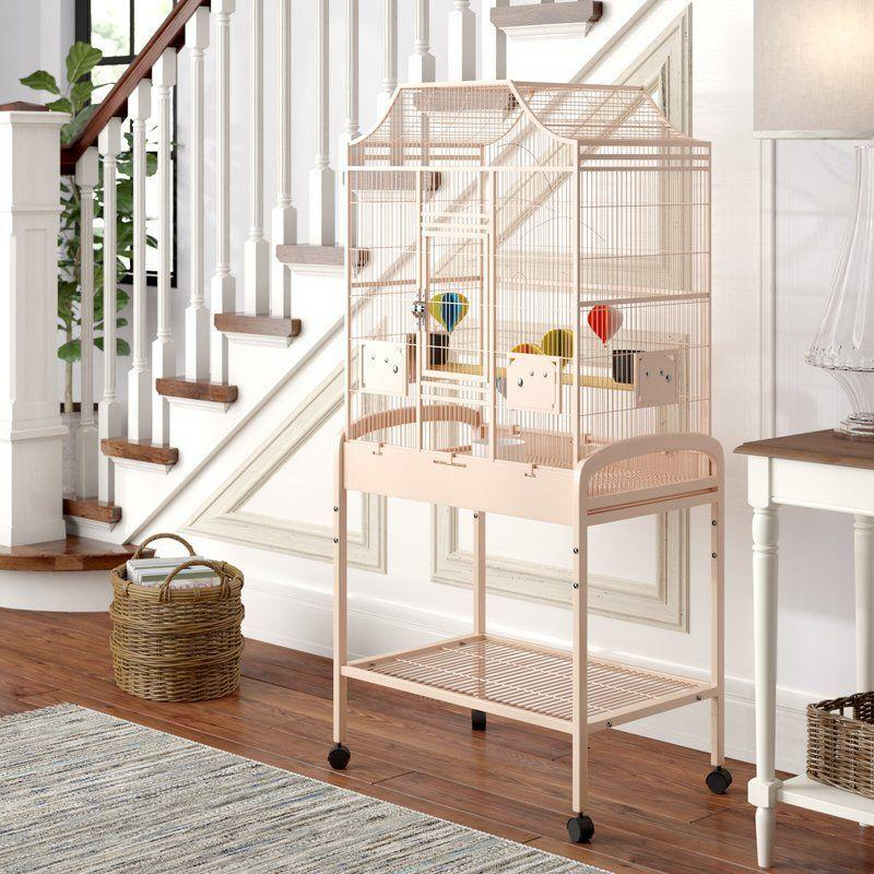 """<h3><strong>Chic Bird Cage</strong></h3><p>Big bird cages aren't always eyesores — embrace your birdie's home as part of your decor with this roomy blush-pink cage with an elegant Victorian design.</p><br><br><strong>Archie & Oscar</strong> Elinor Flight Cage, $161.74, available at <a href=""""https://www.wayfair.com/pet/pdp/archie-oscar-elinor-elegant-style-flight-cage-w000021270.html"""" rel=""""nofollow noopener"""" target=""""_blank"""" data-ylk=""""slk:Wayfair"""" class=""""link rapid-noclick-resp"""">Wayfair</a>"""