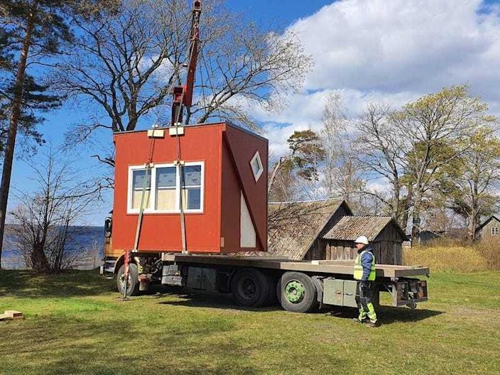 A Brette Haus tiny home being transported on a trailer.