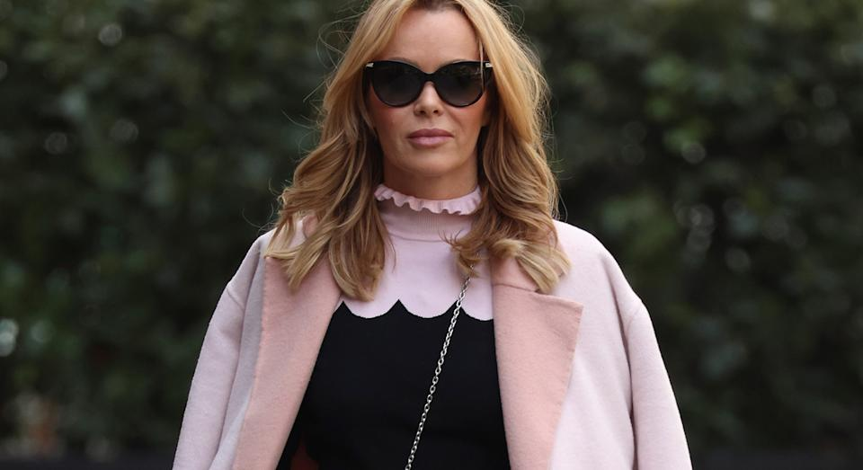 Amanda Holden channels her inner Elle Woods in a pink colour block ensemble as she co-hosts Heart Breakfast radio.  (Getty Images)