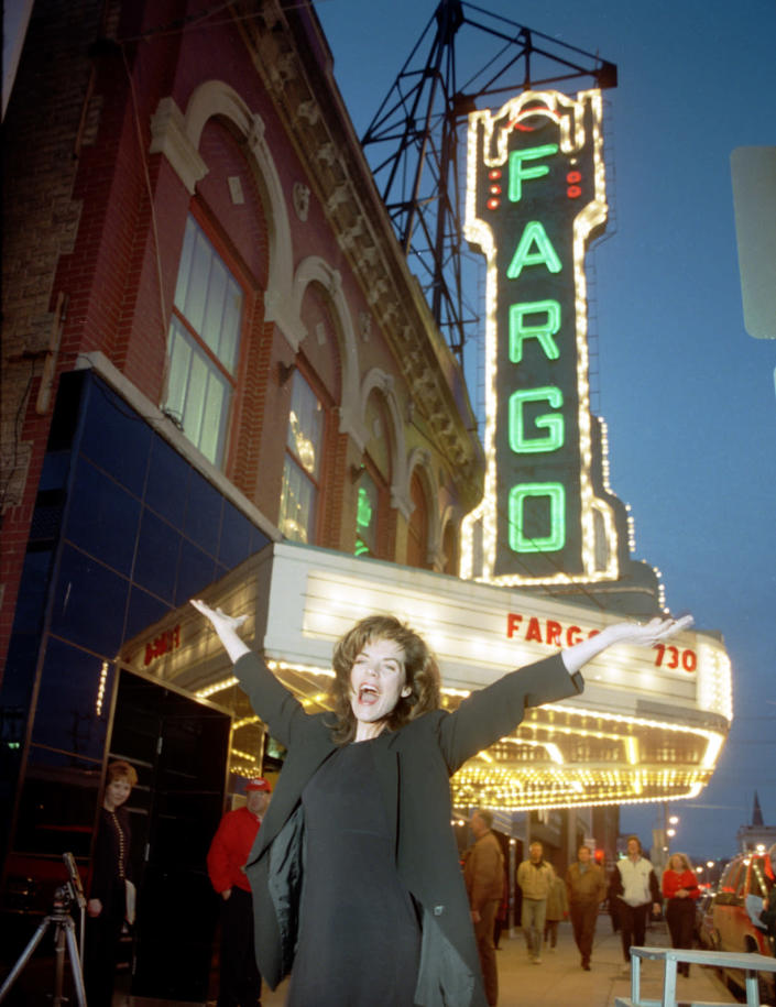 """In this photo taken March 21, 1996, """"Fargo"""" Actress Kristin Rudrud poses at the movie screening, in front of the Fargo Theatre in Fargo, N.D. When the movie Fargo debuted in 1996, many residents in the North Dakota city were not fans of the film's dark humor, not to mention the heavy accents. But the fame and cash from the movie eventually brought many Fargo residents around. Now, 16 years later, Fargo awaits the debut of a new cable television show by the same name. And many residents are less apprehensive about how their hometown will be portrayed this time around. (AP Photo/The Forum, Nick Carlson)"""