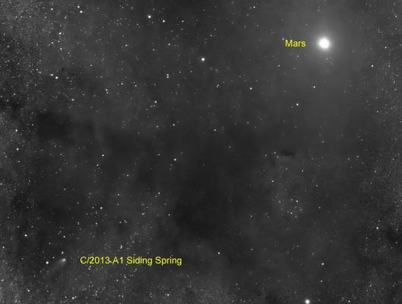 The Comet Siding Spring (C/2013 A1) is seen near Mars on Oct. 19, 2014 by a telescope with the Slooh Community Observatory during a rare flyby that scientists called a once-in-a-lifetime event. The comet flew within 87,000 miles of the surface