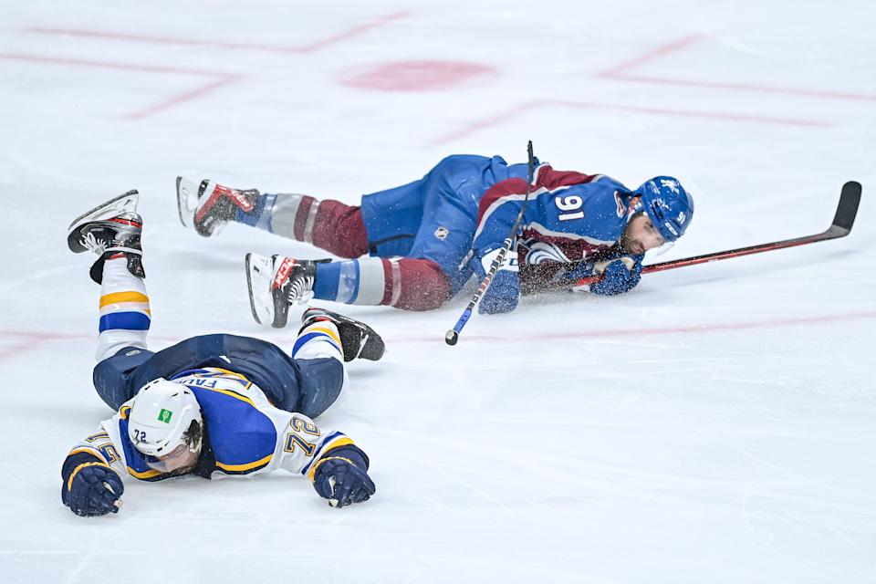 DENVER, CO - MAY 19: St. Louis Blues defenseman Justin Faulk (72) and Colorado Avalanche center Nazem Kadri (91) collide in the third period on a play that would result in a match penalty in the third period during a Stanley Cup Playoffs first round game between the St. Louis Blues and the Colorado Avalanche at Ball Arena in Denver, Colorado on May 19, 2021. (Photo by Dustin Bradford/Icon Sportswire via Getty Images)