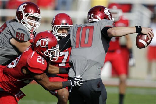 Washington State quarterback Jeff Tuel (10) is sacked by Utah defensive back Reggie Topps (28) in the first quarter of an NCAA college football game, Saturday, Nov. 3, 2012, in Salt Lake City. (AP Photo/Rick Bowmer)
