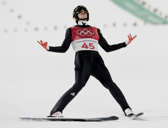 Robert Johansson, of Norway, celebrates after his jump during the men's normal hill individual ski jumping competition at the 2018 Winter Olympics in Pyeongchang, South Korea, Sunday, Feb. 11, 2018. (AP Photo/Kirsty Wigglesworth)