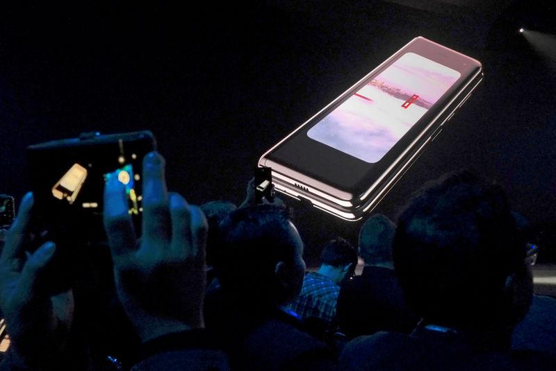 FILE PHOTO: The Samsung Galaxy Fold phone is shown on a screen at Samsung Electronics Co Ltd's Unpacked event in San Francisco, California, U.S., February 20, 2019 REUTERS/Stephen Nellis/File Photo