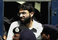 FILE- In this March 29, 2002 file photo, Ahmed Omar Saeed Sheikh, the alleged mastermind behind Wall Street Journal reporter Daniel Pearl's kidnap-slaying, appears at the court in Karachi, Pakistan. On Thursday, Dec. 24, 2020, a provincial court in Pakistan overturned a Supreme Court Decision that Sheikh should remain in custody during an appeal of his acquittal on charges he murdered Pearl. (AP Photo/Zia Mazhar, File)