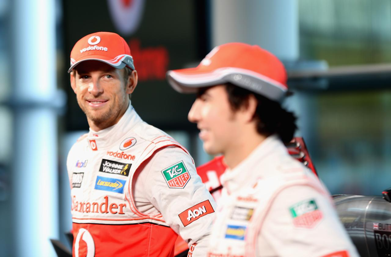 WOKING, ENGLAND - JANUARY 31:  (L - R) McLaren Mercedes Formula 1 drivers Jenson Button of Great Britain and Sergio Perez of Mexico prepare to unveil the Mercedes McLaren MP4-28 at the McLaren technology centre on January 31, 2013 in Woking, England.  (Photo by Mark Thompson/Getty Images)