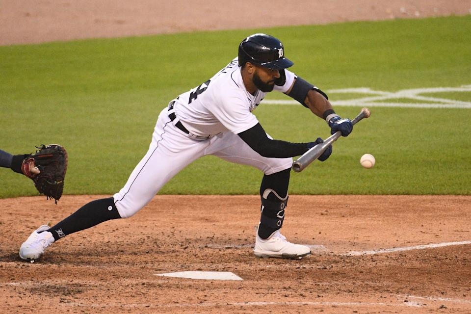 Detroit Tigers center fielder Derek Hill (54) bunts during the fifth inning against the Boston Red Sox at Comerica Park on August 4, 2021.