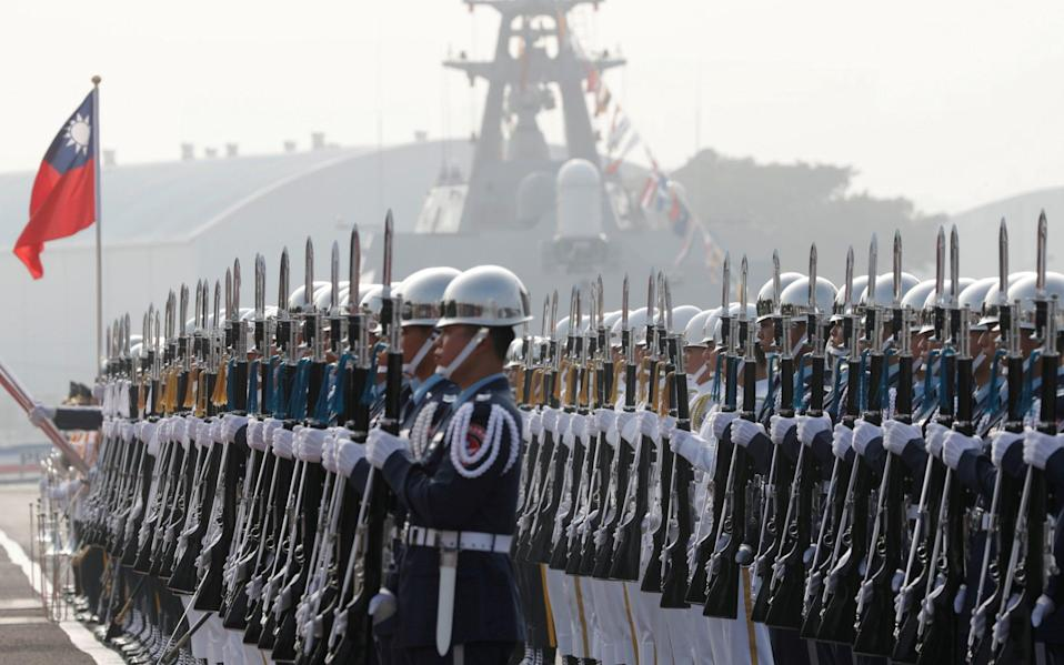 Taiwan's navy sailors take part in a commissioning ceremony of guided missile frigates in 2018 - Reuters