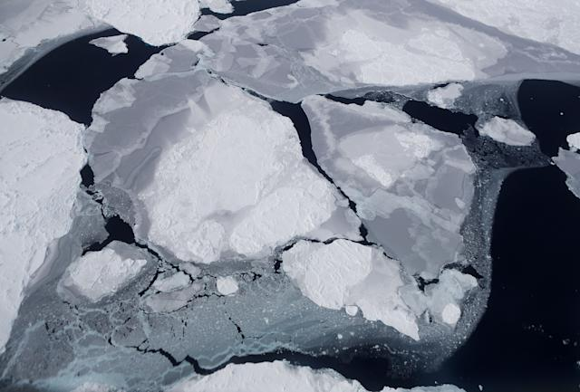 <p>Sea ice seen from aboard NASA's research aircraft in the Antarctic Peninsula region, on Nov. 3, 2017, above Antarctica. (Photo: Mario Tama/Getty Images) </p>