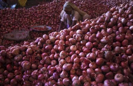 India curbs onion shipments by imposing minimum export price