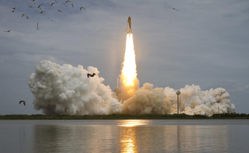 Space shuttle Atlantis is seen as it launches from pad 39A on Friday, July 8, 2011  at the Kennedy Space Center Friday, July 8, 2011, in Cape Canaveral, Fla. Atlantis is the 135th and final space shuttle launch for NASA.  (AP Photo/ NASA, Bill Ingalls)
