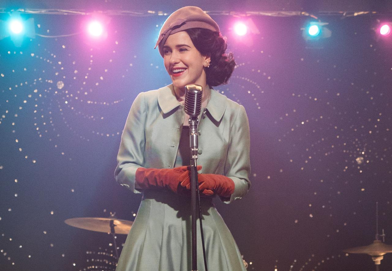 """<em>The Marvelous Mrs. Maisel,</em> starring the perfectly cast Rachel Brosnahan, is one of Amazon's biggest hits. The Emmy-winning series follows the titular character as she embarks on a stand-up comedy career in the 1950s. Come for the comedy; stay for the amazing costumes and sets. <em>Available to watch on</em> <a href=""""https://www.amazon.com/gp/video/detail/B07KYVPH7V"""" rel=""""nofollow"""" target=""""_blank""""><em>Amazon Prime Video</em></a>"""