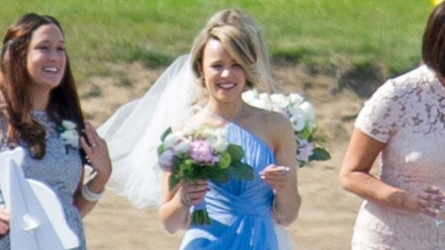 "Like so many over Memorial Day weekend, Rachel McAdams participated in a family wedding. The <em>Aloha </em>actress was the maid of honor to her younger sister, Kayleen, and just like in every romantic movie she's been in, the gal was filled with emotion. An eyewitness tells ET that Rachel laughed and cried a few tears during her sibling's big day. The source also says she looked genuinely happy for her sister and was a dutiful maid of honor who tended to the bride's needs, including holding her bouquet during the ceremony, making sure the wedding dress was in perfect form and fetching a handbag before the post-ceremony photos. FameFlynet <strong> PHOTOS: Famous and Fabulous Celebrity Bridesmaids </strong> Hmm, will Kayleen repay the maid of honor duty for Rachel soon? After all, the 36-year-old beauty was recently rumored to be dating her <em>Southpaw </em>co-star Jake Gyllenhaal. But alas, Gyllenhaal told Ellen DeGeneres while appearing on her show last month that he's single ""for now."" <strong>PHOTOS: On-Screen to Real Life Romance</strong> So while we continue to hold out hope that we'll someday see photos of Rachel as a blushing bride herself, take a look at her sister and you'll see a striking resemblance. Simply stunning! Check out the video below to see Bradley Cooper talk about his great chemistry with McAdams."