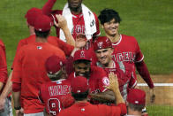 Los Angeles Angels players, including Shohei Ohtani, right and catcher Max Stassi (in front of Ohtani) celebrate their win over the Minnesota Twins in a baseball game, Thursday, July 22, 2021, in Minneapolis. (AP Photo/Jim Mone)