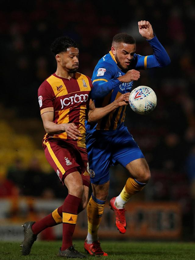 "Soccer Football - League One - Bradford City vs Shrewsbury Town - Northern Commercials Stadium, Bradford, Britain - April 12, 2018 Shrewsbury Town's Carlton Morris in action with Braford City's Timothee Dieng Action Images/Lee Smith EDITORIAL USE ONLY. No use with unauthorized audio, video, data, fixture lists, club/league logos or ""live"" services. Online in-match use limited to 75 images, no video emulation. No use in betting, games or single club/league/player publications. Please contact your account representative for further details."