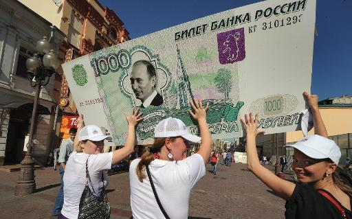 Russian ruble hits new low against dollar, euro on OPEC decision