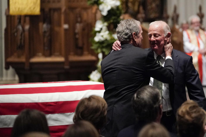 Former President George W. Bush embraces former Secretary of State James Baker, right, after he gave a eulogy during the funeral for former President George H.W. Bush at St. Martin's Episcopal Church, Thursday, Dec. 6, 2018, in Houston. (Photo: David J. Phillip, Pool/AP)