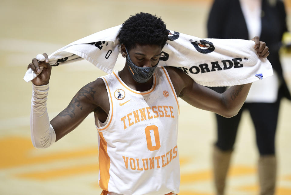 Tennessee guard Davonte Gaines (0) walks off the court after losing to Missouri in an NCAA college basketball game Saturday, Jan. 23, 2021, in Knoxville, Tenn. (Calvin Mattheis/Knoxville New-Sentinel via AP, Pool)