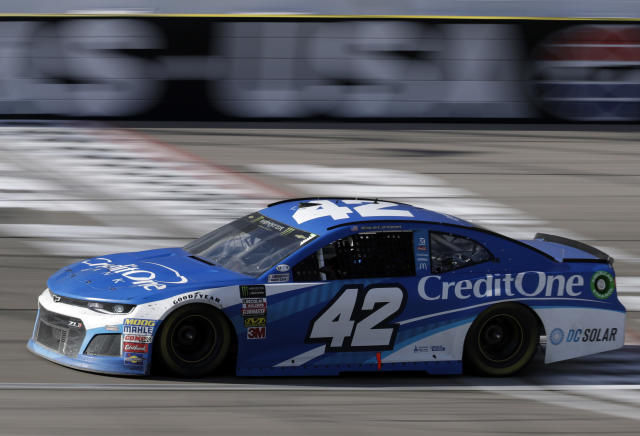 Kyle Larson crosses the start/finish line during a NASCAR Cup series auto race Sunday, March 4, 2018, in Las Vegas. (AP Photo/Isaac Brekken)