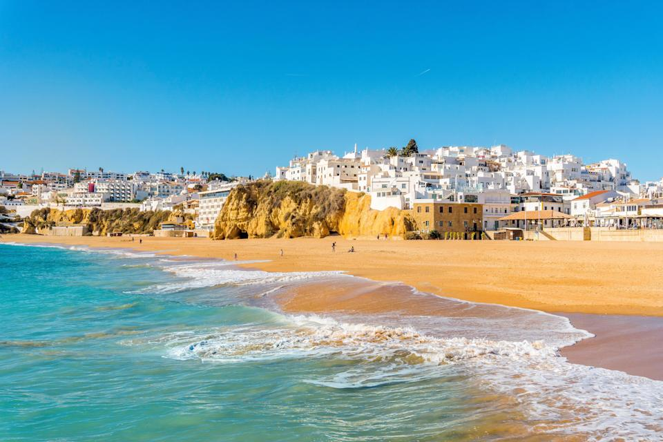 <p>The wide sandy beach in the white city of Albufeira, on the Algarve</p> (Shutterstock)