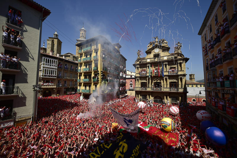 Revellers celebrate the official opening of the 2019 San Fermin fiestas in Pamplona, Spain, Saturday July 6, 2019. (Photo: Alvaro Barrientos/AP)