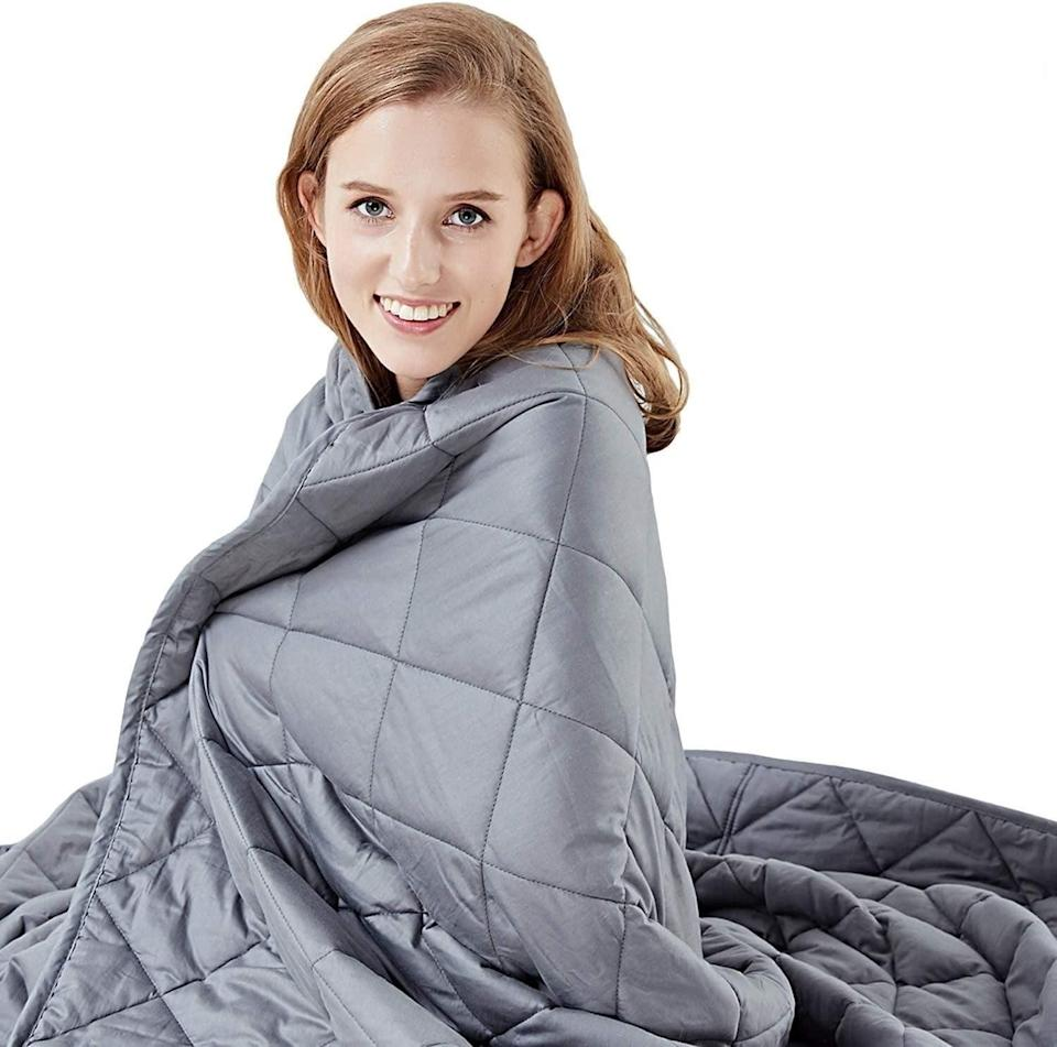 """<p>We're wrapping ourselves up in this <a href=""""https://www.popsugar.com/buy/Hypnoser-Weighted-Blanket-557399?p_name=Hypnoser%20Weighted%20Blanket&retailer=amazon.com&pid=557399&price=32&evar1=fit%3Aus&evar9=47315539&evar98=https%3A%2F%2Fwww.popsugar.com%2Ffitness%2Fphoto-gallery%2F47315539%2Fimage%2F47315546%2FHypnoser-Weighted-Blanket&list1=shopping%2Camazon%2Cstress%20relief%2Canxiety%2Chealthy%20living&prop13=mobile&pdata=1"""" class=""""link rapid-noclick-resp"""" rel=""""nofollow noopener"""" target=""""_blank"""" data-ylk=""""slk:Hypnoser Weighted Blanket"""">Hypnoser Weighted Blanket</a> ($32, originally $90).</p>"""
