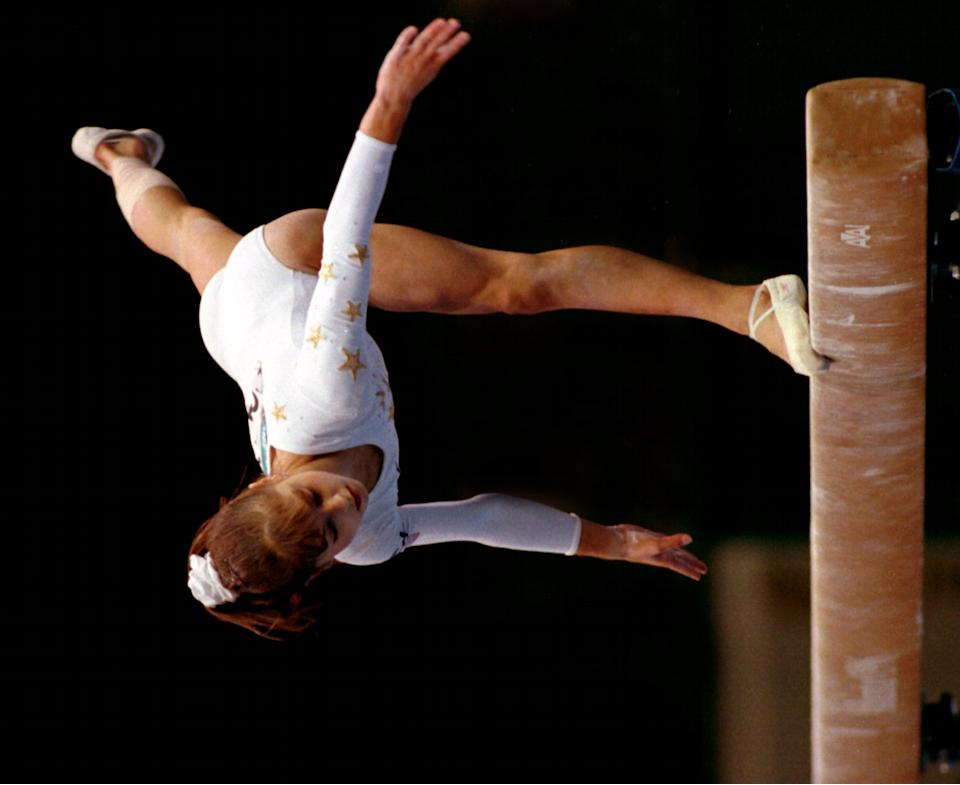ATLANTA - JULY 25: U.S. gymnast Dominique Moceanu almost falls of the balance beam while performing her routine in the women's gymnastics competition during the 1996 Summer Olympic Games in Atlanta, Ga. She scored a 9.6. (Photo by Jim Davis/The Boston Globe via Getty Images)