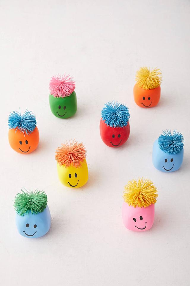 "<p>Honestly, who doesn't need this <a href=""https://www.popsugar.com/buy/Happy-Face-Rubber-Stress-Ball-522573?p_name=Happy%20Face%20Rubber%20Stress%20Ball&retailer=urbanoutfitters.com&pid=522573&price=4&evar1=savvy%3Aus&evar9=45472903&evar98=https%3A%2F%2Fwww.popsugar.com%2Fsmart-living%2Fphoto-gallery%2F45472903%2Fimage%2F46937738%2FHappy-Face-Rubber-Stress-Ball&list1=gifts%2Choliday%2Cstocking%20stuffers%2Cgift%20guide%2Cgifts%20under%20%24100%2Cgifts%20under%20%2450%2Cgifts%20under%20%2475&prop13=mobile&pdata=1"" rel=""nofollow"" data-shoppable-link=""1"" target=""_blank"" class=""ga-track"" data-ga-category=""Related"" data-ga-label=""https://www.urbanoutfitters.com/shop/happy-face-rubber-stress-ball?category=stocking-stuffers&amp;color=095&amp;type=REGULAR"" data-ga-action=""In-Line Links"">Happy Face Rubber Stress Ball</a> ($4) in their life?</p>"
