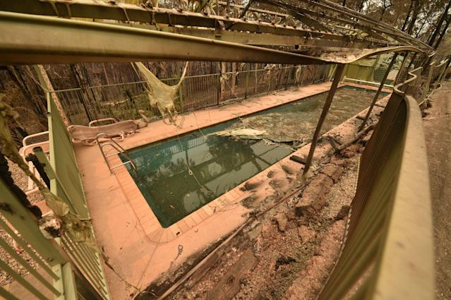 A swimming pool in the remains of a house destroyed by bushfires is seen just outside Batemans Bay in New South Wales on Jan. 2, 2020. (Photo by PETER PARKS/AFP via Getty Images)