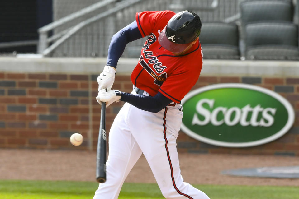 Atlanta Braves first baseman Freddie Freeman connects for a line drive single to center field against the Boston Red Sox during the third inning of a baseball game Sunday, Sept. 27, 2020, in Atlanta. (AP Photo/John Amis)