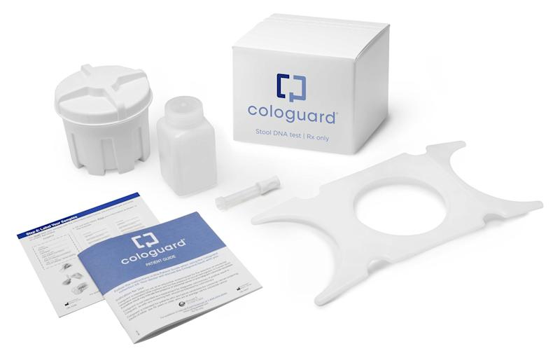 The contents of a Cologuard kit, spread out