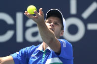 Hubert Hurkacz, of Poland, tosses the ball for a serve to Yannik Sinner, of Italy, during the men's final of the Miami Open tennis tournament Sunday, April 4, 2021, in Miami Gardens, Fla. Hurkacz won 7-6 (4), 6-4. (AP Photo/Lynne Sladky)