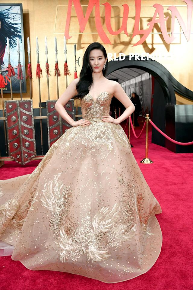 """<p>Liu opted for <a href=""""https://www.popsugar.com/fashion/liu-yifei-gold-gown-at-mulan-premiere-47294615"""" class=""""ga-track"""" data-ga-category=""""Related"""" data-ga-label=""""https://www.popsugar.com/fashion/liu-yifei-gold-gown-at-mulan-premiere-47294615"""" data-ga-action=""""In-Line Links"""">a princess-worthy Elie Saab gown for the <strong>Mulan</strong> premiere</a>.</p>"""