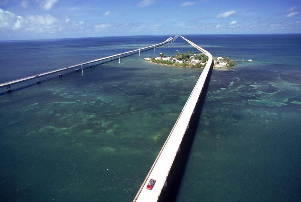 "<p><strong>The Drive: </strong>Overseas Highway</p><p><strong>The Scene:</strong> Driving over the blue-green waters of the Atlantic between the cities of Miami and Key West, the Overseas Highway provides a once-in-a-lifetime experience. Pick an off-season time to avoid a traffic jam, and it'll be smooth sailing for 113 miles. </p><p><strong>The Pit-Stop:</strong> Visit <a href=""http://www.jul.com/"" rel=""nofollow noopener"" target=""_blank"" data-ylk=""slk:Jules' Undersea Lounge"" class=""link rapid-noclick-resp"">Jules' Undersea Lounge</a> (or stay the night!), the world's only underwater hotel. </p>"