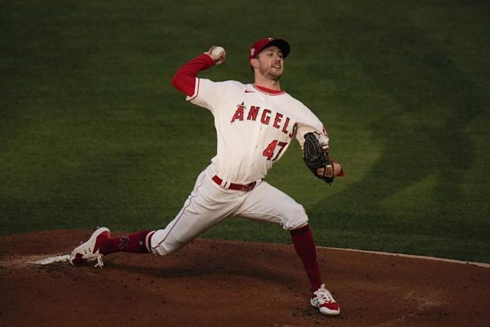 Los Angeles Angels starting pitcher Griffin Canning throws against the Los Angeles Dodgers during the first inning of a baseball game, Friday, May 7, 2021, in Anaheim, Calif. (AP Photo/Jae C. Hong)