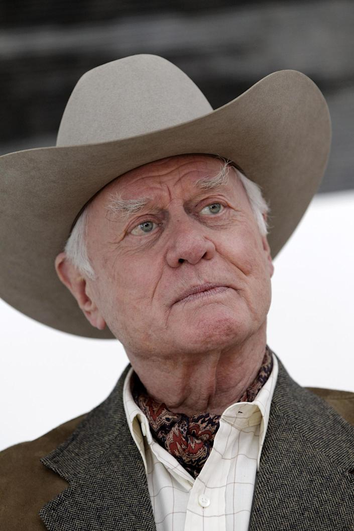 """FILE - In this Nov. 4, 2011 file photo, actor Larry Hagman pauses during an interview on location during the filming for the upcoming new television show """"Dallas"""" in Dallas. Actor Larry Hagman, who for more than a decade played villainous patriarch JR Ewing in the TV soap Dallas, has died at the age of 81, his family said Saturday Nov. 24, 2012. (AP Photo/Tony Gutierrez, File)"""