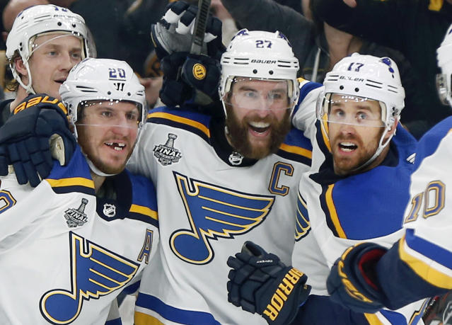 St. Louis Blues' Alex Pietrangelo, second from right, celebrates his goal with teammates Jay Bouwmeester, left rear, Alexander Steen, left, and Jaden Schwartz, right, during the first period in Game 7 of the NHL hockey Stanley Cup Final, Wednesday, June 12, 2019, in Boston. (AP Photo/Michael Dwyer)