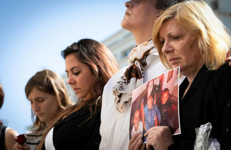 The mother (right) of Johanna, who was stabbed to death by her partner in front of their three children, attended a rally against domestic violence in Le Havre, northwest France